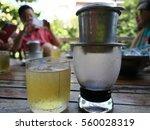 vietnamese drip coffee and... | Shutterstock . vector #560028319