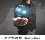 globe  earth in human hand ... | Shutterstock . vector #560035627