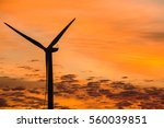 sunset showing wind turbine... | Shutterstock . vector #560039851