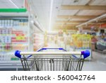 supermarket aisle with empty... | Shutterstock . vector #560042764