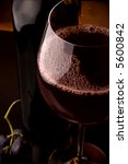 red wine glass and bottle details grape - stock photo