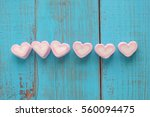 pink heart shape marshmallow on ... | Shutterstock . vector #560094475