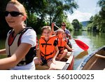 young family canoeing | Shutterstock . vector #560100025