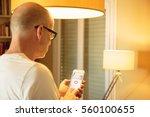 smart home  man controlling... | Shutterstock . vector #560100655