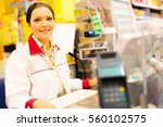 Small photo of Sales Clerk At A Cash Register In The Supermarket
