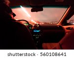 riding on cars on the road at... | Shutterstock . vector #560108641