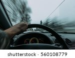 riding behind the wheel of a... | Shutterstock . vector #560108779