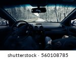 driving a car on winter road.... | Shutterstock . vector #560108785