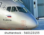 Small photo of MOSCOW, RUSSIA - CIRCA DECEMBER, 2015: Aeroflot Russian airlines Sukhoi Superjet 100 airplane parked to airbridge gate with pilots in cockpit at Moscow Sheremetyevo international airport nose close up