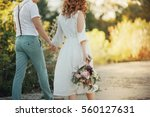 the bride and groom in nature.... | Shutterstock . vector #560127631