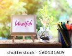 Small photo of Unselfish - words on the canvas with natural background