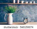 vintage alarm clock with flower ...   Shutterstock . vector #560150074