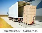 truck transporting goods packed ... | Shutterstock . vector #560187451