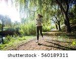 fit beautiful woman jogging in... | Shutterstock . vector #560189311