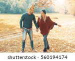young couple in love enjoying... | Shutterstock . vector #560194174