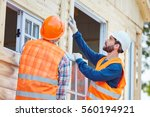 two window fitter cooperating... | Shutterstock . vector #560194921