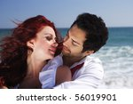 young couple at the beach | Shutterstock . vector #56019901
