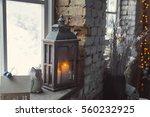 candles on a windowsill. winter. | Shutterstock . vector #560232925