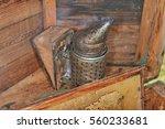 bee hive  smoker and  honeycomb | Shutterstock . vector #560233681