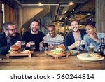 diverse people enjoy food... | Shutterstock . vector #560244814