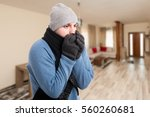 young man feeling cold and... | Shutterstock . vector #560260681