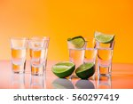 tequila shot with a slice of... | Shutterstock . vector #560297419