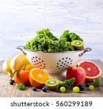 fresh kale  fruits and berries  ... | Shutterstock . vector #560299189