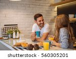 couple eating breakfast early... | Shutterstock . vector #560305201