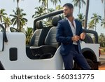handsome man near the car in... | Shutterstock . vector #560313775