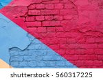 Small photo of Colorful (purple, blue and beige) brick wall as background, texture