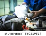 hands of car mechanic with a... | Shutterstock . vector #560319517