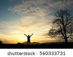 man holding arms up in praise... | Shutterstock . vector #560333731