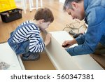 father and son assembling... | Shutterstock . vector #560347381