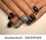 beautiful woman's nails | Shutterstock . vector #560349184