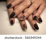 beautiful woman's nails | Shutterstock . vector #560349244