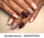 beautiful woman's nails | Shutterstock . vector #560349364