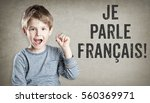 boy says he speaks french  on... | Shutterstock . vector #560369971