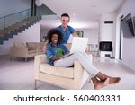 young multiethnic couple... | Shutterstock . vector #560403331