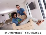 young multiethnic couple... | Shutterstock . vector #560403511