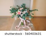 beautiful bouquet of pink and... | Shutterstock . vector #560403631