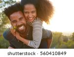 man carrying young woman on his ... | Shutterstock . vector #560410849