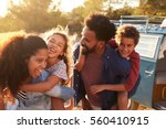 parents giving their kids... | Shutterstock . vector #560410915