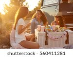 three female friends enjoying a ... | Shutterstock . vector #560411281