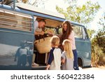 family packing up their camper... | Shutterstock . vector #560422384