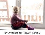 little girl sitting by the...   Shutterstock . vector #560443459