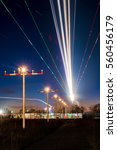 Small photo of Light-trails of approaching aircraft during the evening rush at Frankfurt / Germany.
