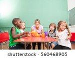 female teacher playing in... | Shutterstock . vector #560468905