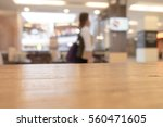 table top and blur interior of... | Shutterstock . vector #560471605
