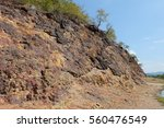 Small photo of a large natural elevation of the earth's surface rising abruptly from the surrounding level