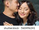 portrait of smiling korean... | Shutterstock . vector #560496241